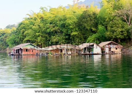 Floating house on the Vajiralongkorn Dam at Kanjanburi, Thailand - stock photo