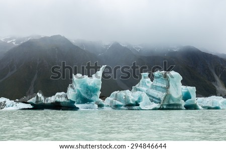 floating icebergs in Tasman Glacier Lake. Aoraki/Mount Cook National Park New Zealand