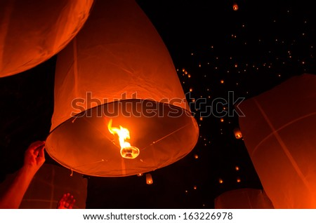 Floating lantern in Yee Peng festival, Buddhist floating lanterns to the Buddha  in Sansai district, Chiang Mai, Thailand. - stock photo
