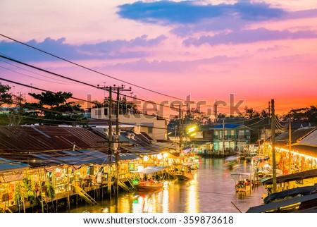 Floating market at night in Amphawa, Samut Songkhram Province, Thailand. - stock photo
