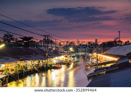 Floating market at night in Amphawa, Samut Songkhram Province, Thailand - Dark tone color - stock photo