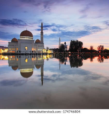 Floating mosque tranquility at sunrise/sunset - stock photo