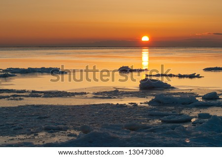 Floating mounds of ice in Lake Erie. - stock photo