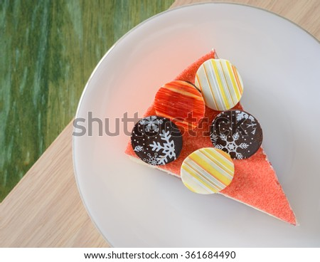 Floating Raspberry White Chocolate Mousse with chocolate coin topping on wooden table - stock photo