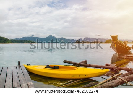 Floating red Canoe in Ratchaprapha Dam at Khao Sok National Park, Thailand.