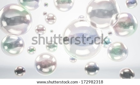 Floating reflective bubbles or glass spheres over a bright white cyc background - stock photo