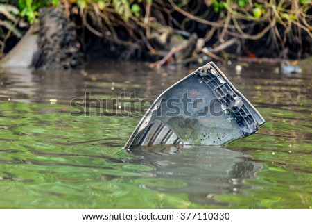 floating spare of the car in river - stock photo