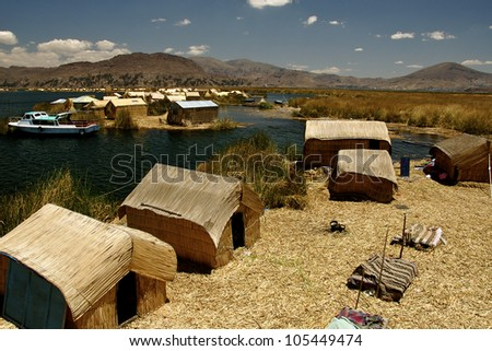 Floating Uros Islands, Lake Titicaca, Peru: Homes on the floating Uros islands of Lake Titicaca, Peru - stock photo