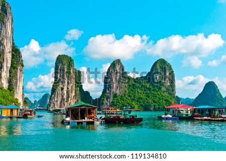Floating village and rock islands in Halong Bay, Vietnam, Southeast Asia - stock photo