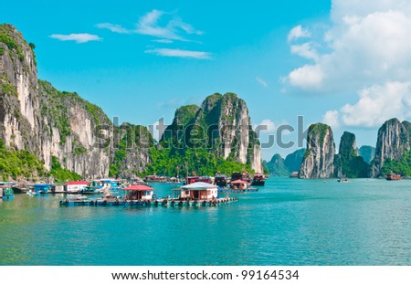 Floating village in Halong Bay, Vietnam, Southeast Asia - stock photo
