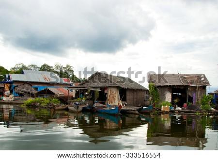 floating village Tonle Sap lake Cambodia Siem Reap - stock photo
