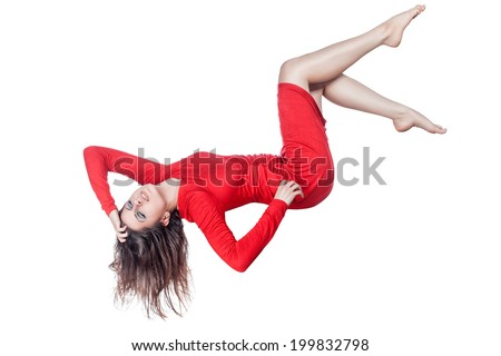 Floating woman in a red dress on a white background. - stock photo
