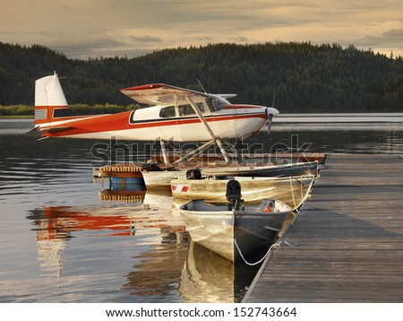 Floatplane moored at a jetty on Canim Lake in British Columbia, western Canada - stock photo