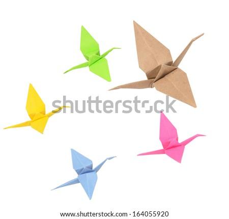 flock of origami birds on white - stock photo