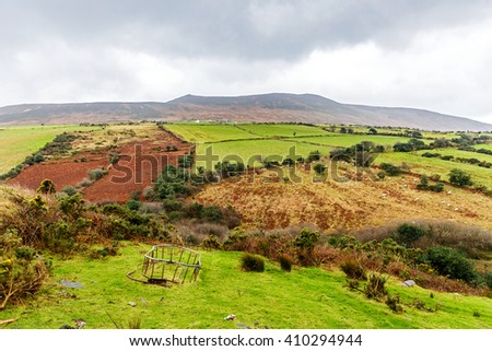 Flock of sheep walking on the hill - stock photo