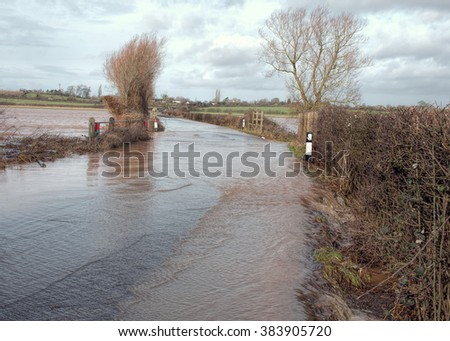 Flood Water Overcoming Road. Flooding - stock photo