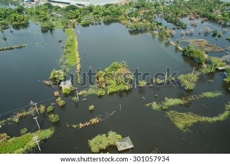 Flood waters overtake a city in Thailand form above view - stock photo