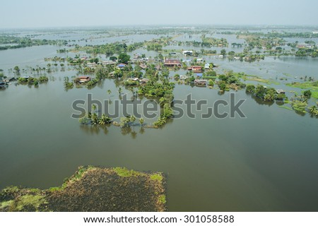 Flood waters overtake a city in Thailand form above view