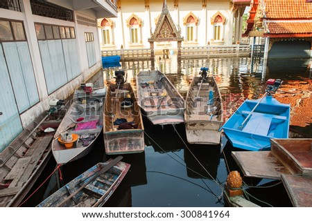 flood waters overtake temple in Thailand - stock photo