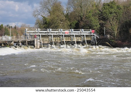 Flood waters passing through a Weir on the River Thames in England