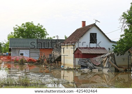 Flooded and Ruined Houses in Floods Natural Disaster - stock photo