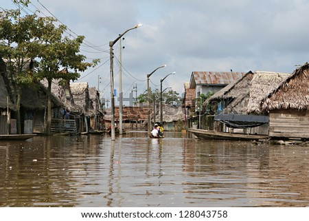 Flooded buildings in the polluted waters of Belen, Iquitos, Peru. Thousands of people live here in extreme poverty without clean water or sanitation. - stock photo