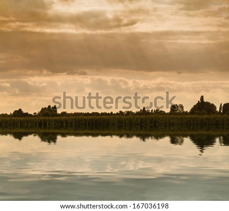 Flooded farmland on dramatic sky - stock photo