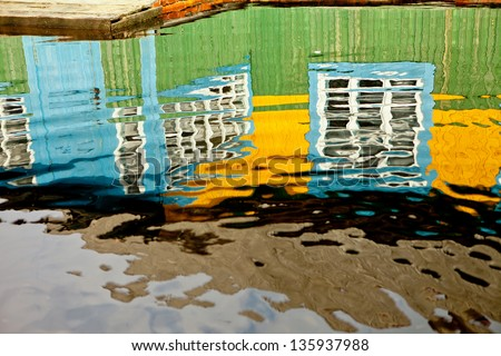 Flooded homes and plots of land in the villages during the spring flood of the river Pripyat. Reflection. - stock photo
