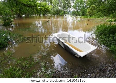 Flooded landscape with lost bathtub. Radbuza river, Pilsen city, Czech republic, Europe. - stock photo