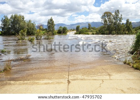 Flooded old concrete road after heavy rains - landscape exterior - stock photo
