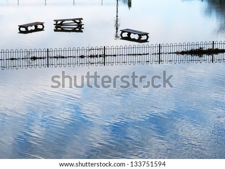Flooded park next to the river thames - stock photo