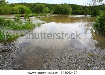 Flooded road. Radbuza river, Pilsen city, Czech Republic, Europe. - stock photo