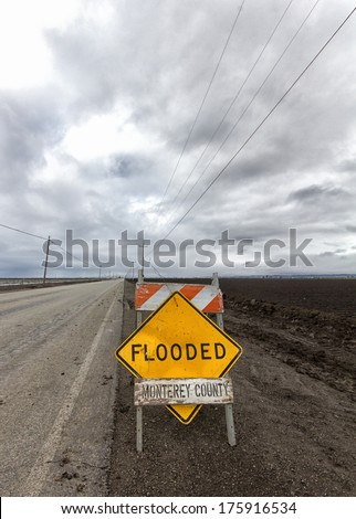 Flooded Roadway Sign Vertical Image in Monterey County, California - stock photo