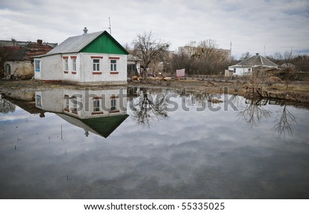 Flooding, house in the water - stock photo