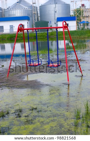 Flooding of the playground because of the construction of a grain elevator/ - stock photo