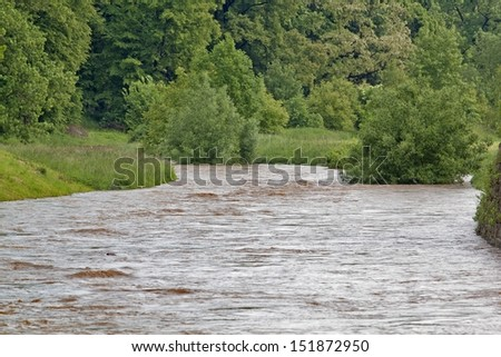 Flooding river - stock photo