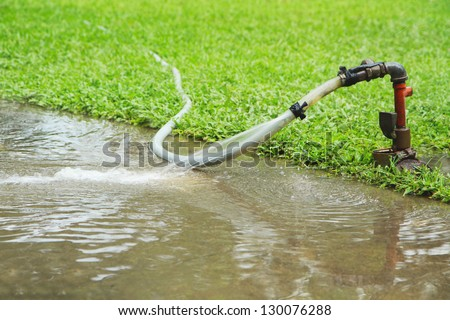 Flooding water running from aged faucet - stock photo