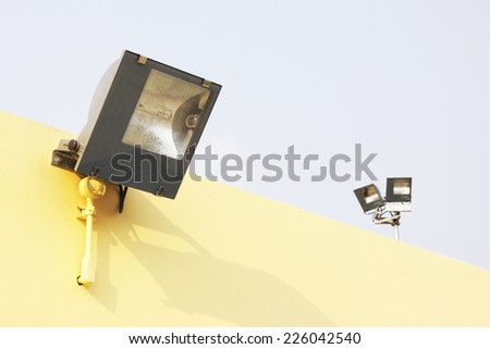 floodlight on building with blue sky - stock photo