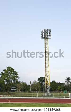 floodlight with metal pole with lane - stock photo