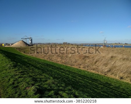 Floodplain excavation at Millingerwaard nature reserve, in order to create more room for the river. Galloway cattle graze in river foreland. RIVER WAAL, THE NETHERLANDS - FEBRUARY 2016 - stock photo