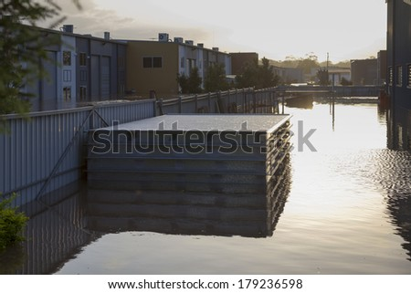 Floodwater in an industrial estate. - stock photo