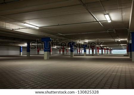 Floor at underground parking lot - stock photo