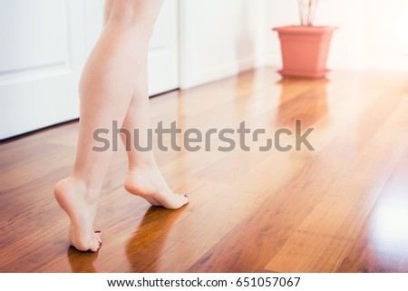 Floor Heating. Young Woman Walking In The House On The Warm Floor. Gently  Walked