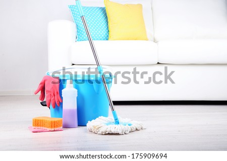 Floor mop and bucket for washing in room - stock photo
