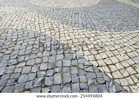 Floor of a street with stone tiles, Lisbon, Portugal. - stock photo