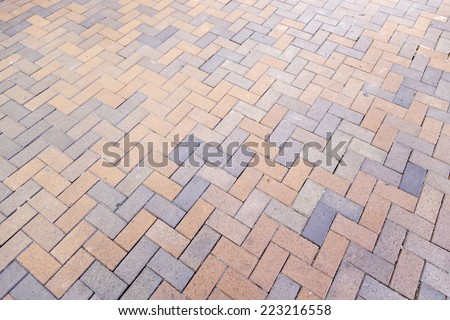 Floor pavers in a path, detail of a pavement to walk, textured background - stock photo