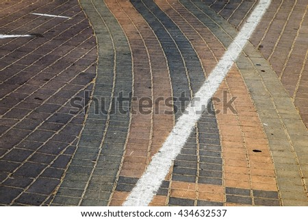 Floor pavers in a path, detail of a pavement to walk, textured background