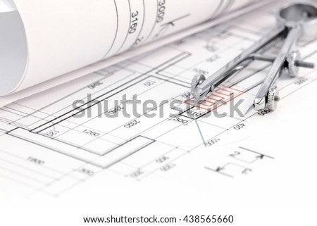 floor plan background with blueprint roll and drawing compass - stock photo