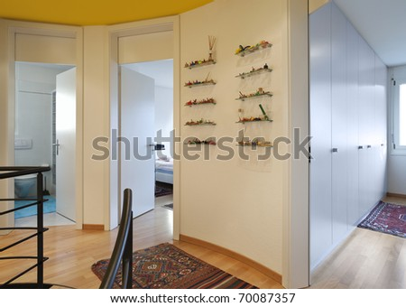 floor with spiral staircase, corridor with carpet - stock photo