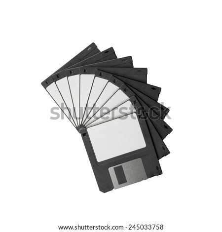 Floppy disks, the old disk storage medium used back in the 80's and 90's, stacked on high in a curved shape. Black disks with white blank labels. - stock photo